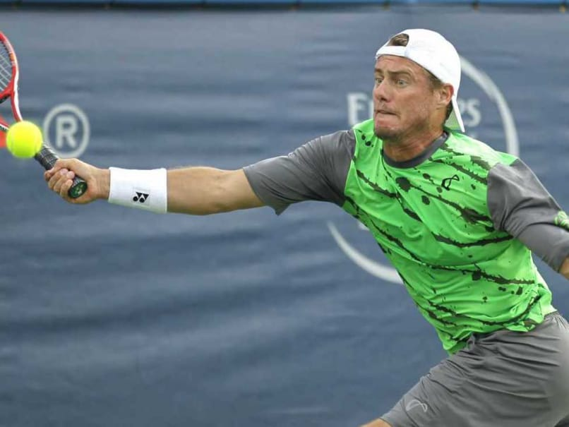 Lleyton Hewitt of Australia reaches for the ball during a game against Milos Raonic, of Canada, at the Citi Open tennis tournament, Thursday, July 31, 2014, in Washington.