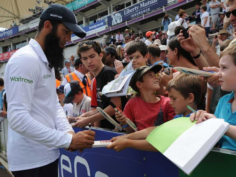 Moeen Ali signs autographs at Southampton where his six wickets won England the Test vs India.