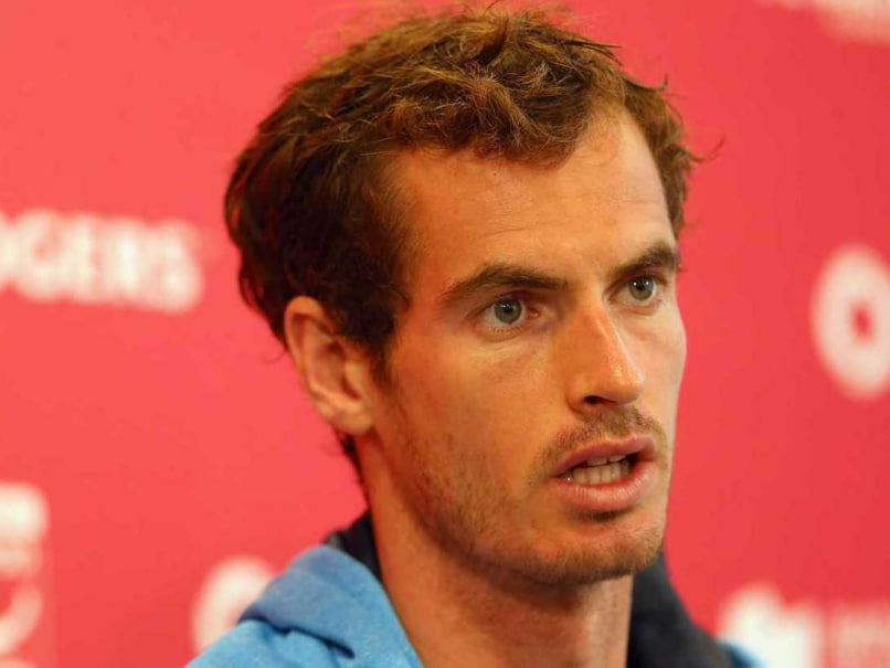 Andy Murray of Great Britain talks with the media during the Rogers Cup at Rexall Centre at York University on August 3, 2014 in Toronto, Canada.