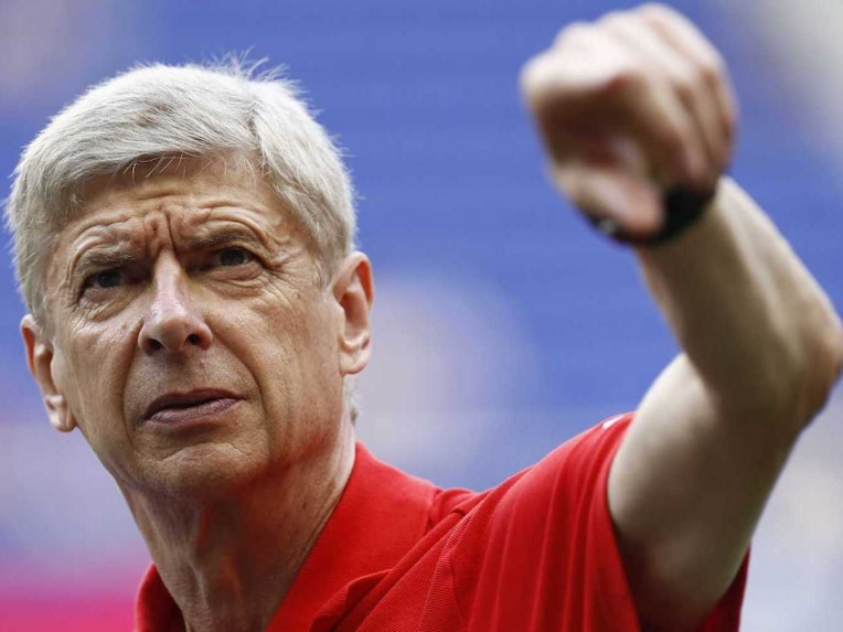 Arsene Wenger, head coach of Arsenal, surveys the pitch before a friendly match against the New York Red Bulls at Red Bull Arena on July 26, 2014.