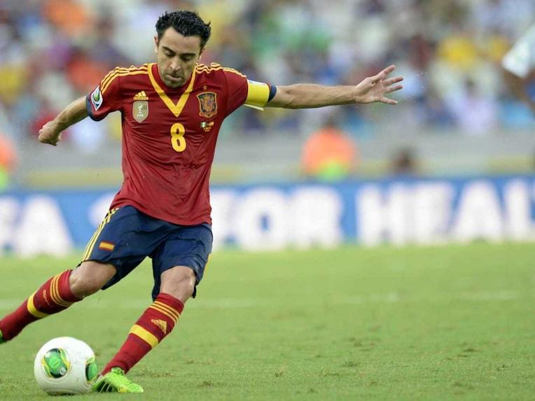 Spains midfielder Xavi Hernandez drives the ball during their FIFA Confederations Cup Brazil 2013 Group B football match against Nigeria