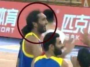 A Sikh basketballer playing without the turban.