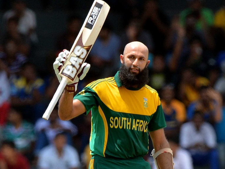 Hashim Amla celebrates after scoring a century during the first ODI between South Africa and Sri Lanka at the R. Premadasa International Cricket Stadium in Colombo on July 6, 2014.
