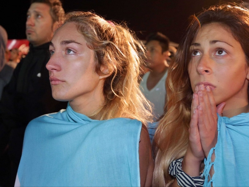 Argentina fans watch their team lose to Germany in the World Cup final.