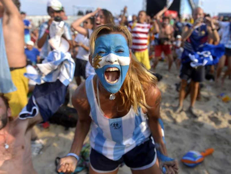 An Argentina fan celebrates after her team advanced to the quarters of FIFA World Cup