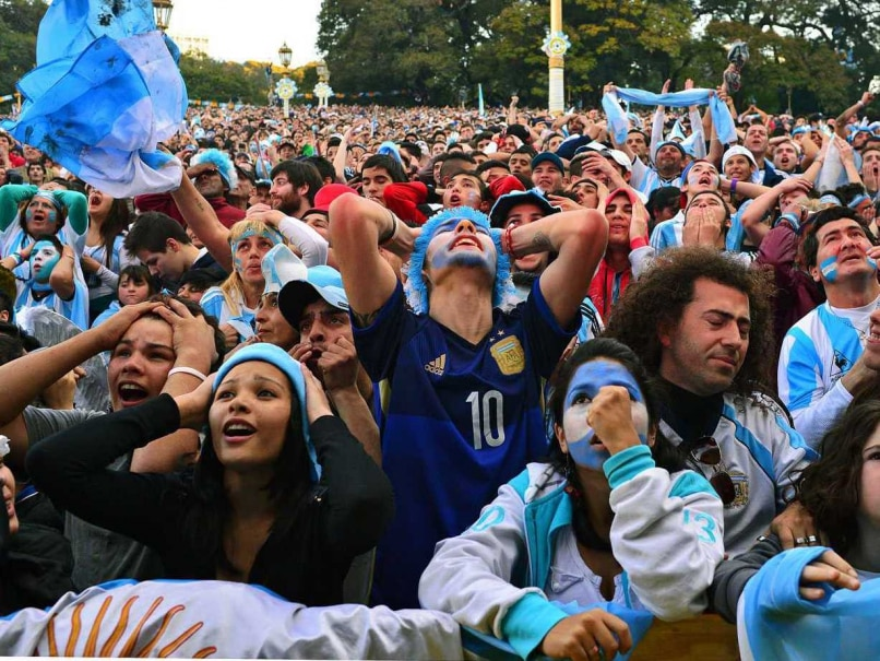 Argentine fans react as they watch the FIFA World Cup Brazil 2014 final between Argentina and Germany on a giant screen at San Martin square in Buenos Aires, on July 13, 2014.