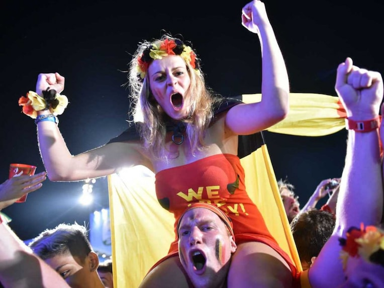 Belgium fans celebrate after their side beat US 2-1 to advance to the last 8 of FIFA World Cup