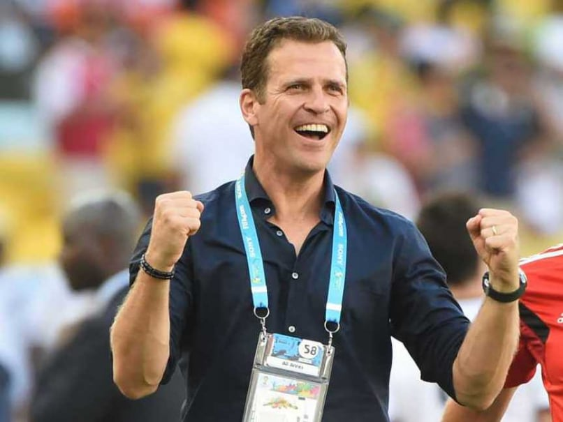 Germanys business manager and former striker Oliver Bierhoff celebrate after victory in the quarter-final between France and Germany at the 2014 FIFA World Cup.