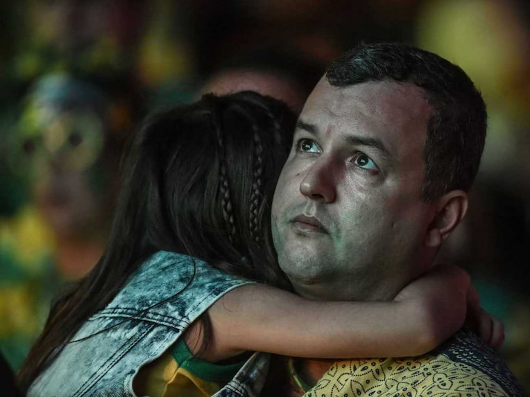 A Brazilian fan reacts watches the 2014 FIFA World Cup semifinal match between Brazil and Germany on a public screen on the streets of Rio de Janeiro, Brazil on July 8, 2014.