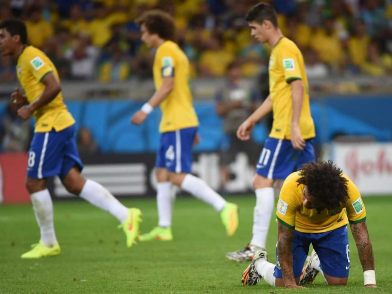 Brazils defender Marcelo reacts after Germanys forward Andre Schuerrle scored during the FIFA World Cup semi-final.