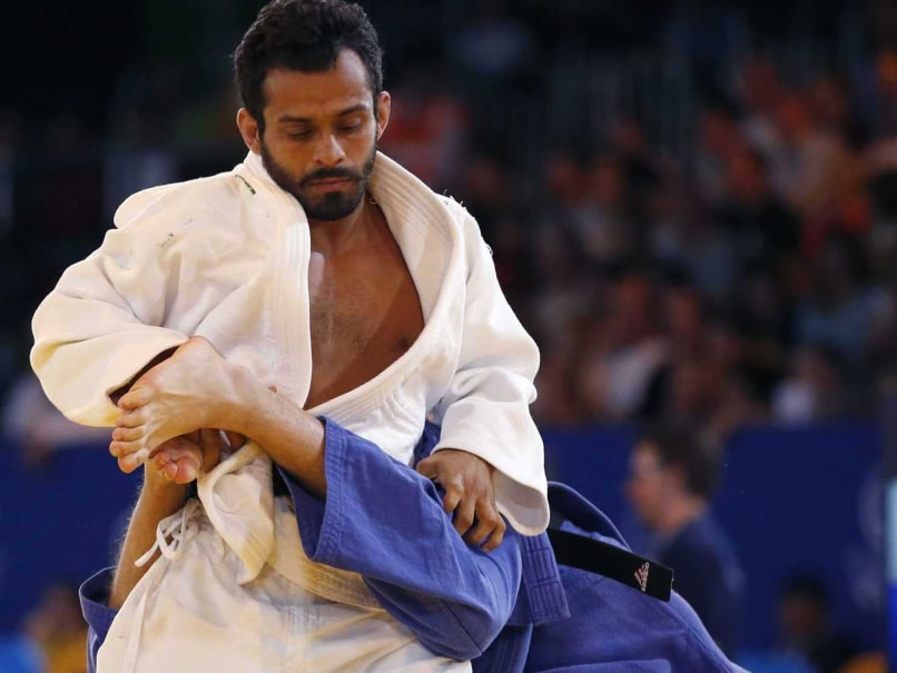 Navjot Chana of India, left, holds down Daniel Le Grange of South Africa during their mens 60 kg judo semifinal bout at the Commonwealth Games Glasgow 2014, in Glasgow, Scotland Thursday, July, 24, 2014.