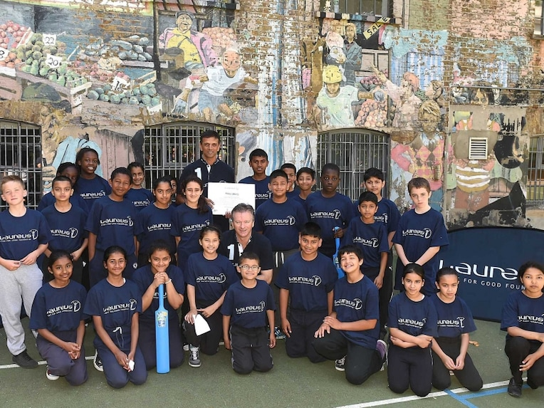 Laureus Academy Members, Rahul Dravid (L) and Steve Waugh (R) pose for photographs with the children during the Rahul Dravid Academy Announcement at Christ Church C of E Primary School on July 16, 2014 in London, England.