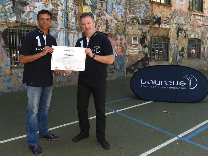 Laureus Academy Members, Rahul Dravid (L) and Steve Waugh (R) pose for photographs during the Rahul Dravid Academy Announcement at Christ Church C of E Primary School on July 16, 2014 in London, England.