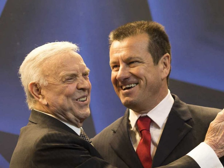 Dunga, right, is embraced by Brazilian Soccer Confederation president Jose Maria Marin, after a press conference announcing Dunga as the new head coach of the Brazilian national team.