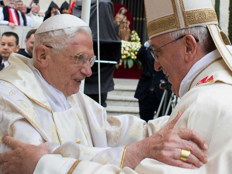 This handout picture released on April 27, 2014 by the Vatican press office shows Pope Francis (R) meeting with Pope emeritus Benedict XVI during the canonisation mass of Popes John XXIII and John Paul II on St Peters square at the Vatican on April 27, 2014.