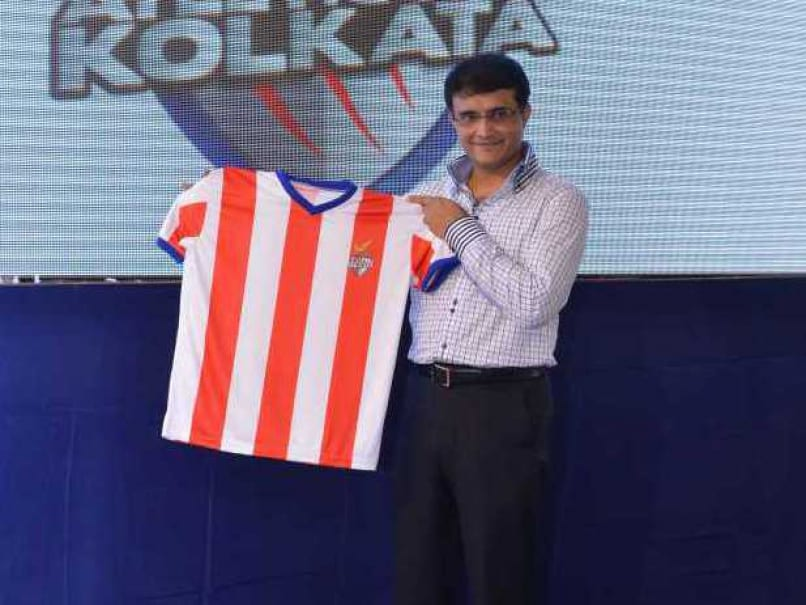 Sourav Ganguly poses with a jersey of his Indian Super League franchise Atletico de Kolkata