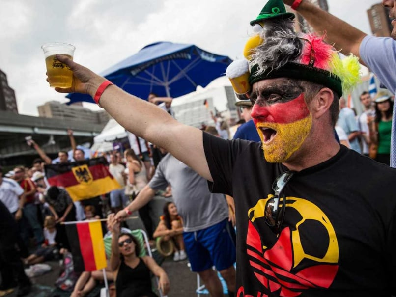 John Martin celebrates after Germany defeated Brazil in the semi-final World Cup game on July 8, 2014 in New York City. Germany scored an unprecendented five unanswered goals in the first half of the game and went on to win 7-1.