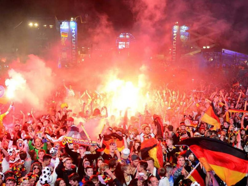 German fans celebrate at an outdoor screening near the Brandenburg Gate in Berlin, on July 13, 2014, as Germany won the FIFA World Cup 2014 final.
