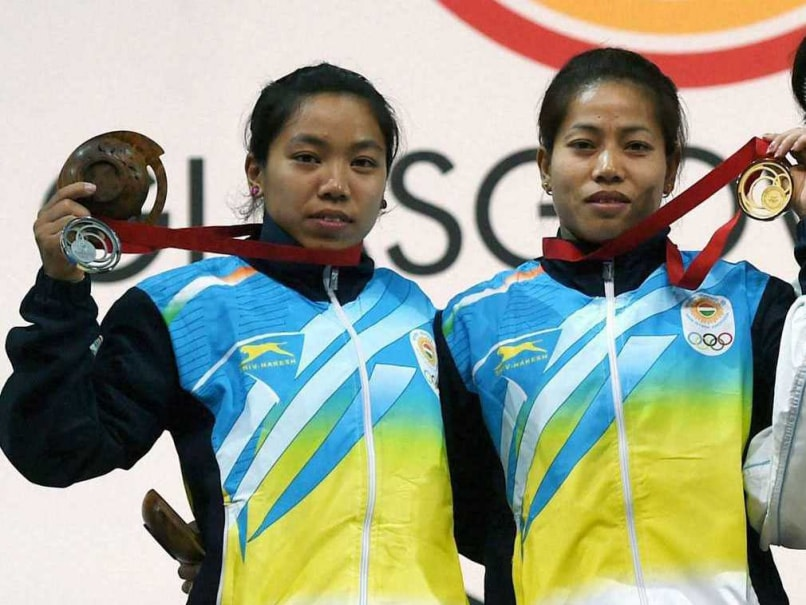 Khumukcham Sanjita Chanu lifted a total of 173 kg to get gold while Mirabai Chanu lifted 170 kg to win silver in the womens 48 kg weightlifting category at the Commonwealth Games.