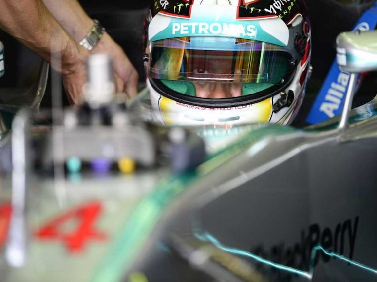 Mercedes-AMGs British driver Lewis Hamilton sits in the pits during the second practice session at the Silverstone circuit in Silverstone