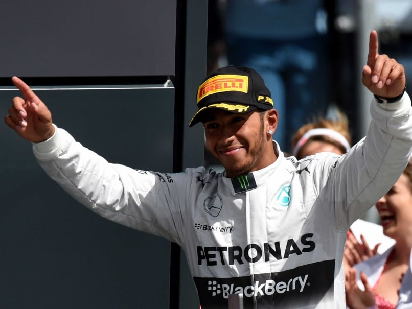 Mercedes-AMGs British driver Lewis Hamilton celebrates on the podium at the Silverstone circuit in Silverstone on July 6, 2014 after the British Formula One Grand Prix.