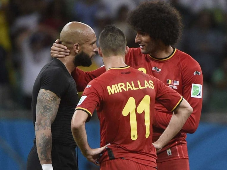 Club Mates! Former Everton midfielder and Belgian international Marouane Fellaini has a chat with Everton and US goalkeeper Tim Howard as Everton and Belgium player Kevin Mirallas looks on after the pre-quarters clash in the FIFA World Cup