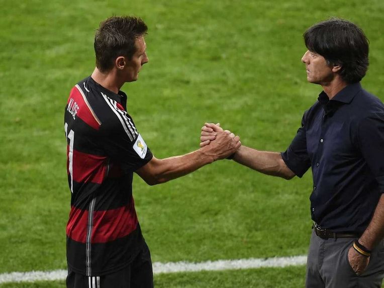 Germanys forward Miroslav Klose (L) is congratulated by Germanys coach Joachim Loew after breaking Ronaldos World Cup record of 15 goals.