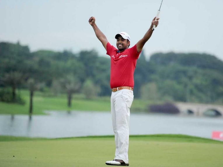 Anirban Lahiri reacts after making a successful putt.
