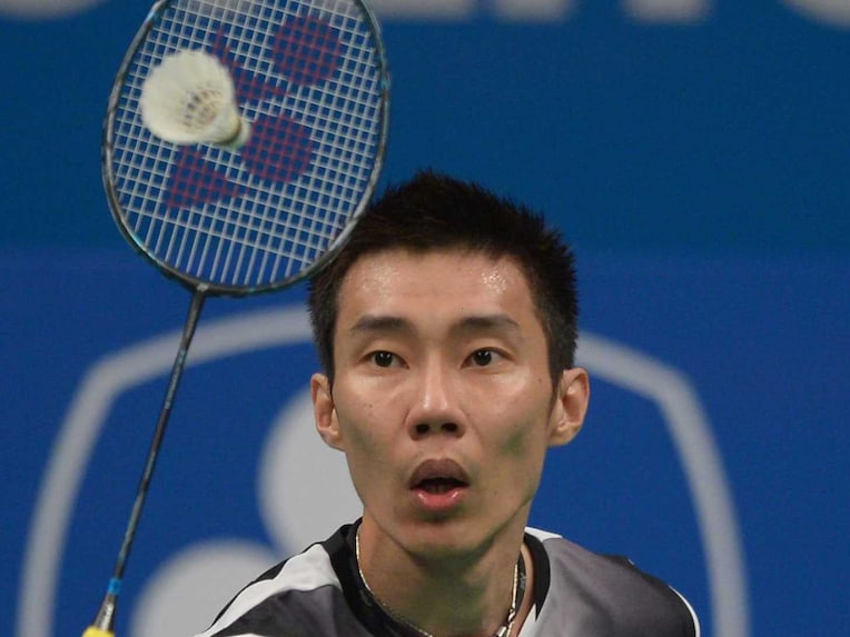 Lee Chong Wei of Malaysia hits a return against Kenichi Tago of Japan at the badminton 2014 Indonesia Open men singles semi-final match in Jakarta on June 21, 2014.