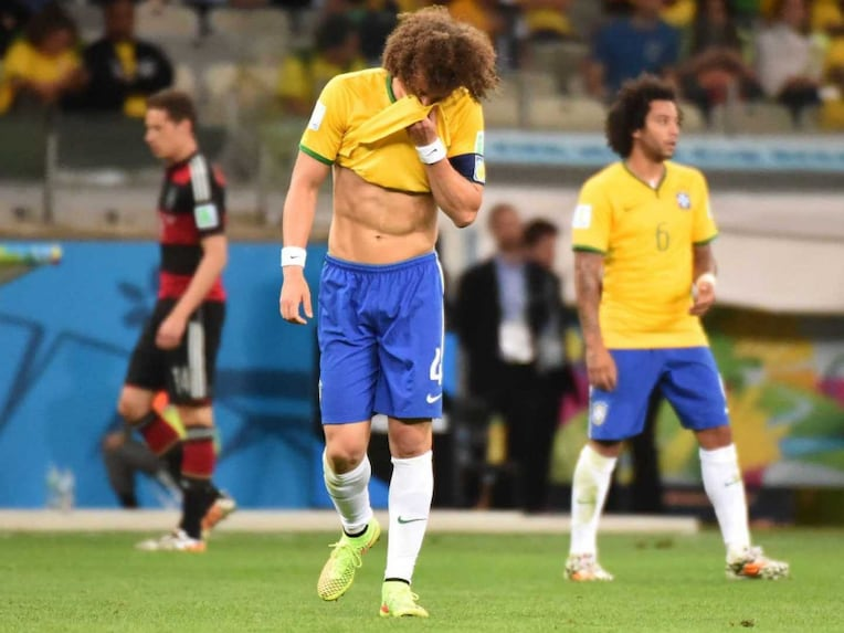 Brazils defender David Luiz (C) reacts after the seventh German goal during the FIFA World Cup semi-final.