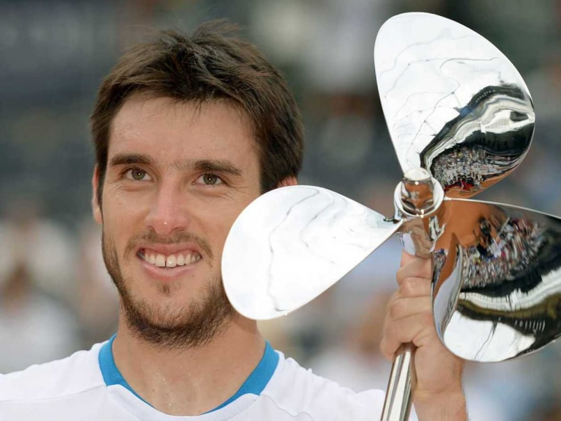 Argentina's Leonardo Mayer celebrates with his trophy after the final match against Spain's David Ferrer (not pictured) of the ATP tennis tournament in Hamburg.