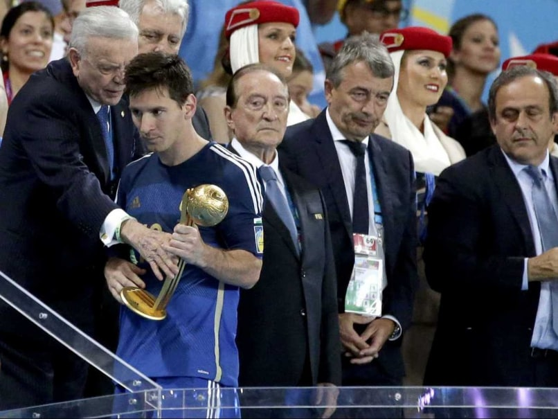 Lionel Messi receives the Golden Ball award after the FIFA World Cup 2014 final.