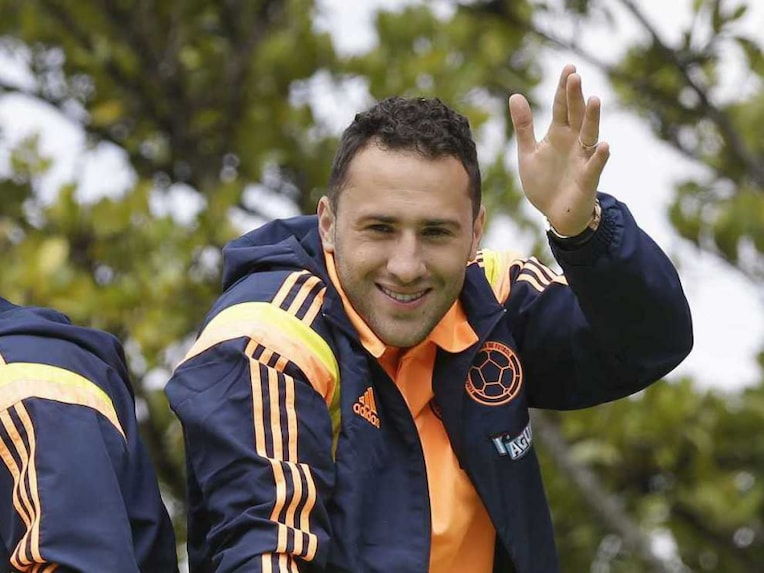 Colombia's goalkeeper David Ospina waves to supporters during a homecoming celebration.