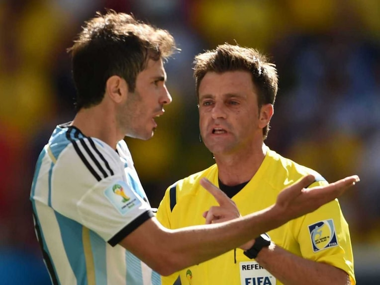 rgentinas defender Jose Maria Basanta (L) argues with Italian referee Nicola Rizzoli during a quarter-final football match between Argentina and Belgium