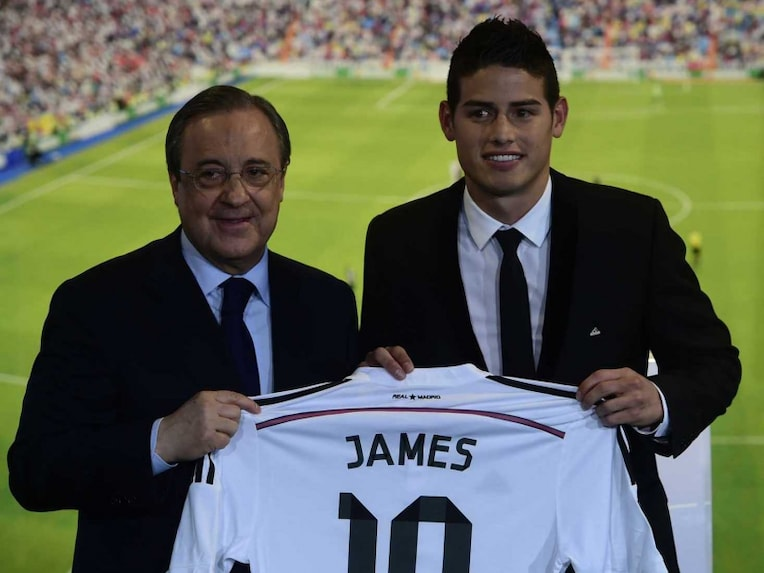 Real Madrids president Florentino Perez (L) and Colombian striker formerly at AS Monaco James Rodriguez pose during his presentation at the Santiago Bernabeu stadium following his signing with Spanish club Real Madrid.