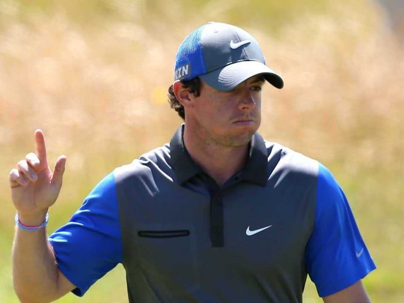 Northern Ireland's Rory McIlroy reacts on the 13th green during his first round on the opening day of the 2014 British Open Golf Championship at Royal Liverpool Golf Course in Hoylake, north west England on July 17, 2014.
