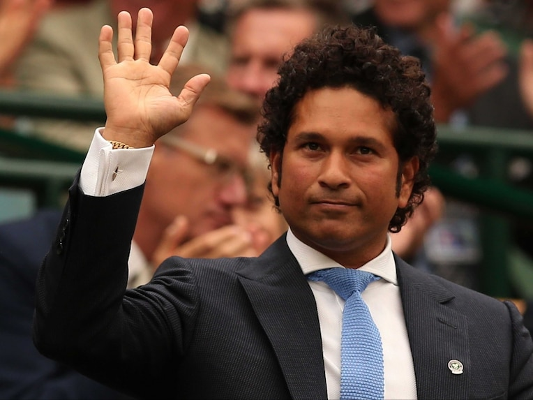Sachin Tendulkar stands and waves in the royal box on centre court in Wimbledon before the start of the mens singles third round match between Spains Rafael Nadal and Kazakhstans Mikhail Kukushkin.