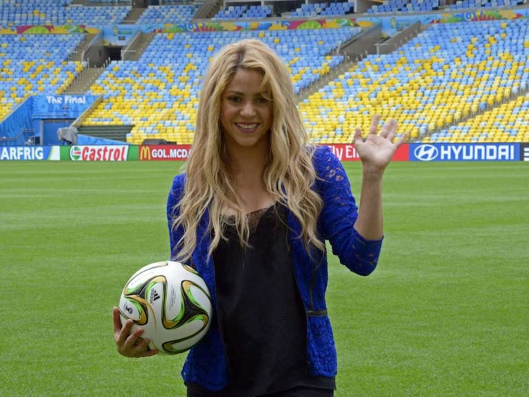 Colombia Pop singer Shakira poses with a football ball on the pitch of the Maracana stadium in Rio de Janeiro on July 12, 2014, a day before the 2014 FIFA World Cup final between Germany and Argentina.