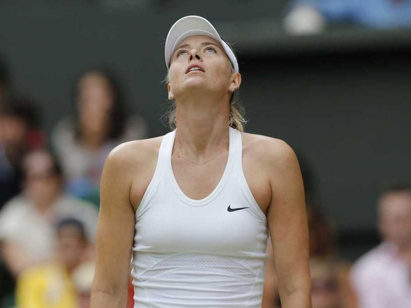 Maria Sharapova reacts after being dumped out of the Wimbledon in 4th Round