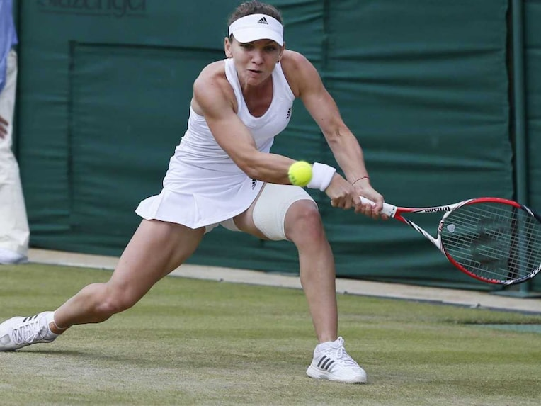 Simona Halep plays a shot during her 4th round match in Wimbledon 2014