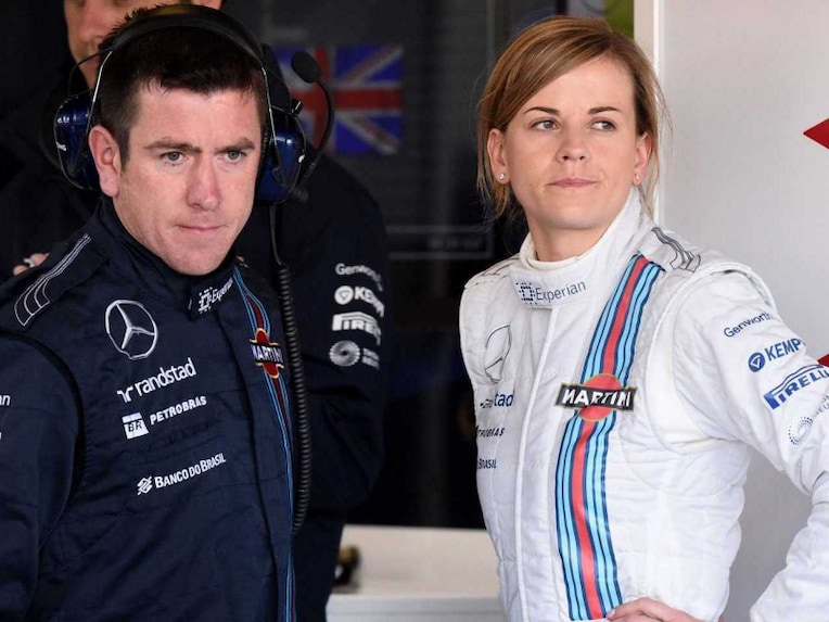 Williams' Scottish test driver Susie Wolff talks to team mates in the pits during the first practice session at the Silverstone circuit.