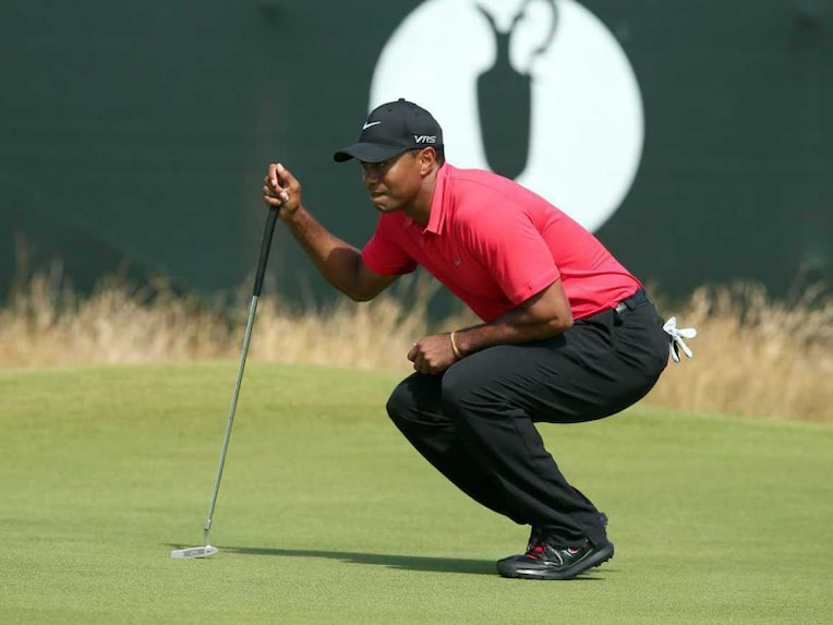 iger Woods lines up his putt on the 7th green during his fourth round, on the final day of the 2014 British Open Golf Championship at Royal Liverpool Golf Course in Hoylake, north west England.