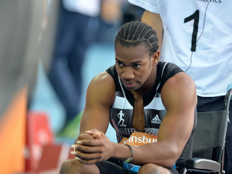 Jamaicas Yohan Blake is taken away in a wheelchair after falling down while competing in the mens 100m race on the first day of the IAAF Diamond League athletics meeting in Glasgow, Scotland, on July 11, 2014.