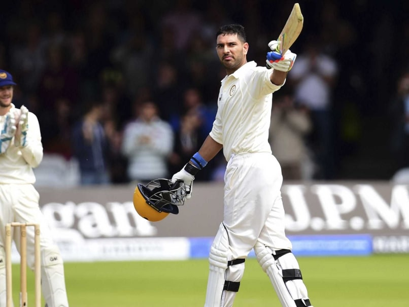 Rest of the Worlds Yuvraj Singh celebrates his century against The Marylebone Cricket Club during the clubs bicentenary cricket match at Lords Cricket Ground, London Saturday July 5, 2014.