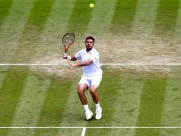 Wimbledon 2014: Stanislas Warinka Marches Into Fourth Round