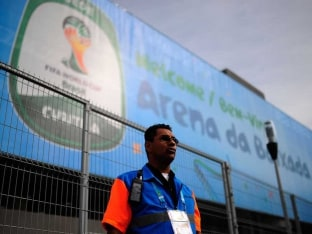 azilian workers are racing to complete the stadium that will host the World Cups first game