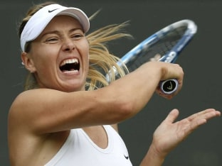 Maria Sharapova plays a return shot during Wimbledon 2014