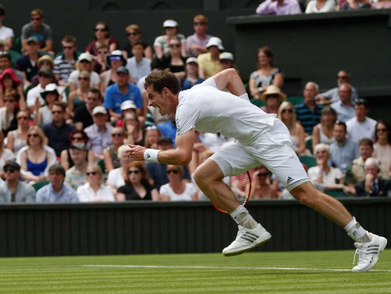 Andy Murray in action during Wimbledon 2014