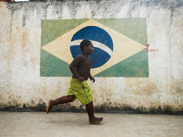 Brazil football fan runs