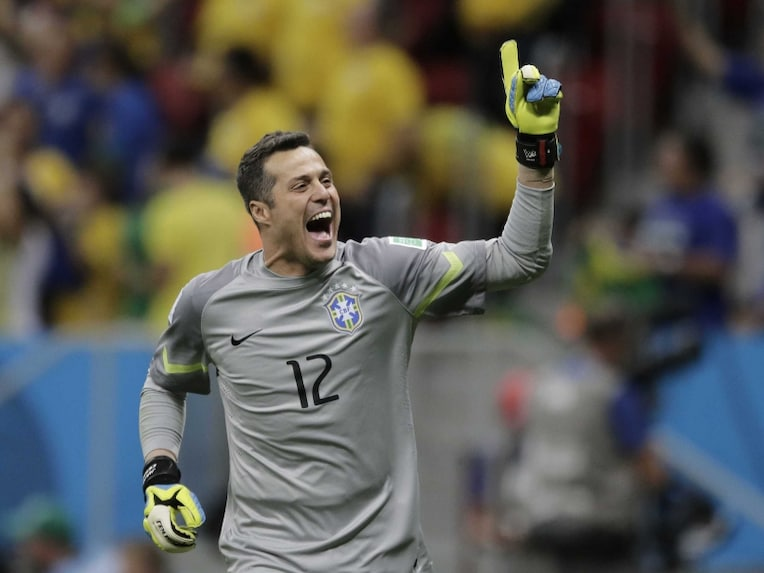 Brazils goalkeeper Julio Cesar celebrates as Brazil take the lead in the penalty shootout vs Chile in the FIFA World Cup Round of 16.